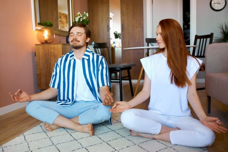 couple practice yoga