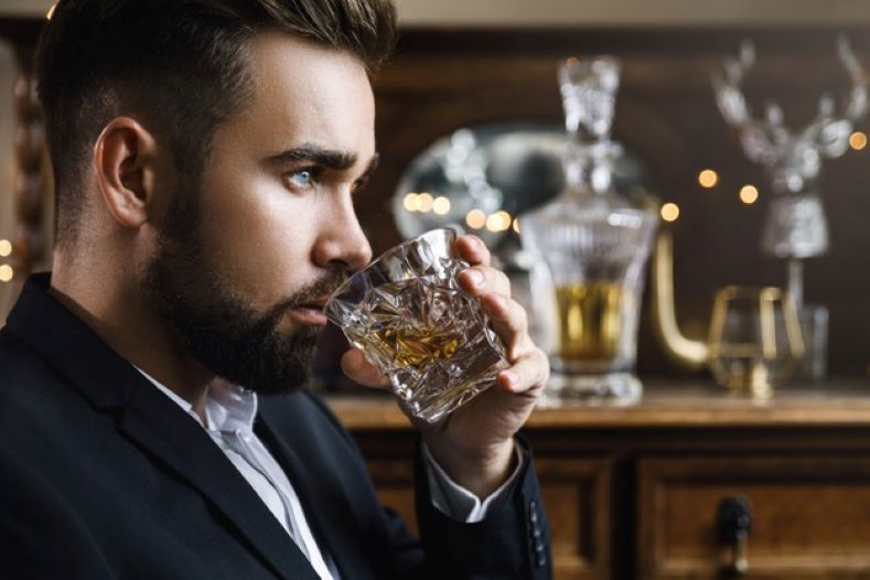 man with glass whiskey