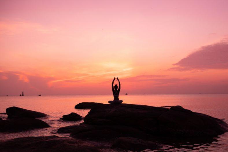 practice yoga on beach