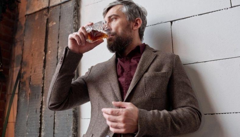 stylish man drinking whisky